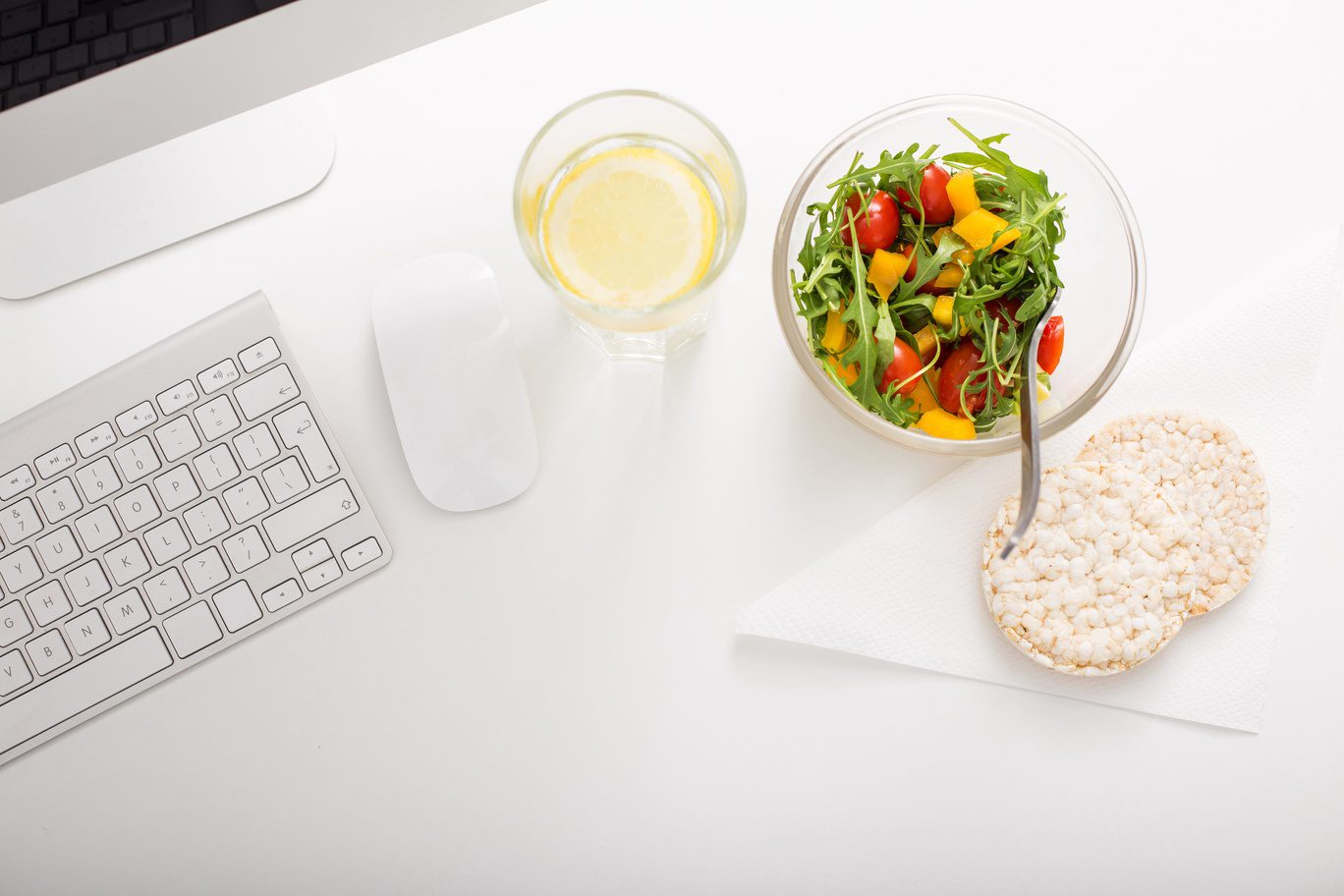laptop, vegetarian meal and bread on the table
