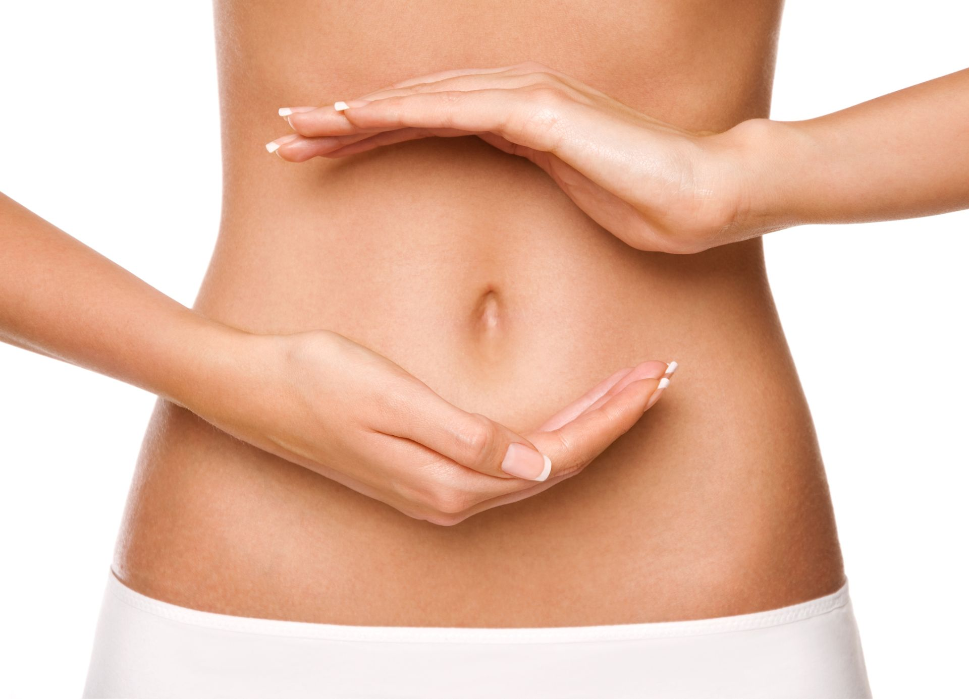 Female shaping circle with hands on her stomach. Isolated on white